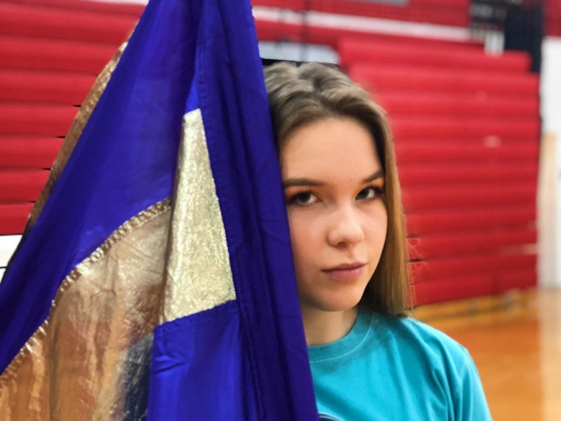Agata Soltys posing with her flag.