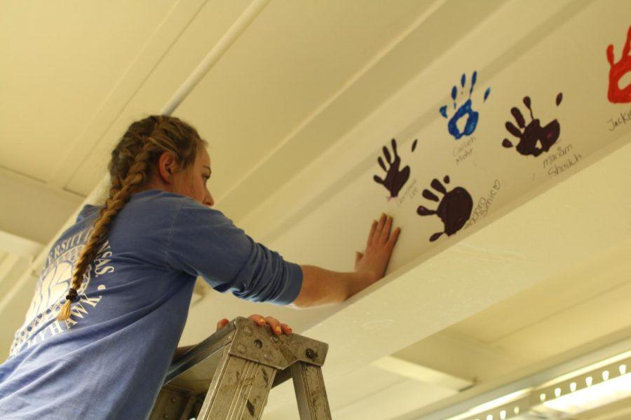 Senior+Julia+Karpilovsky+leaves+her+mark+on+Niles+West+with+her+handprint.+
