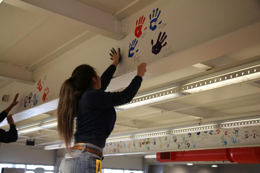 Senior Sarah Cohen leaves her mark on Niles West with her handprint.