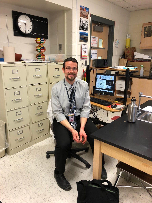 Biology teacher Thomas Jodelka prepares for another class.