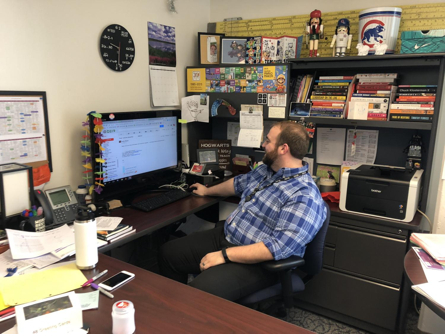 Math Director Lucas Leavenworth hard at work in his office.
