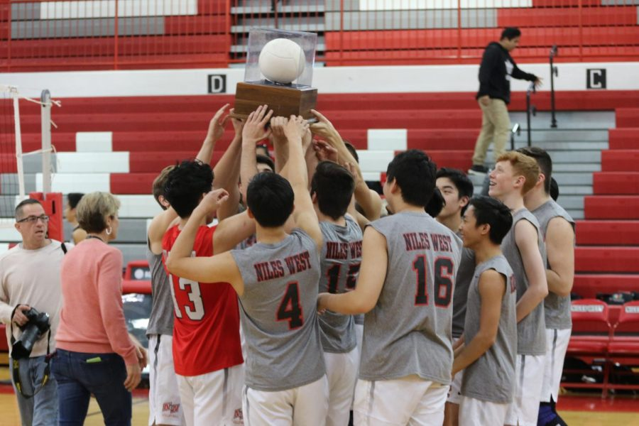 The boys gathering around their regional championship trophy from last year.