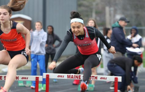Tiffany Chin completing her hurdles for the competition.