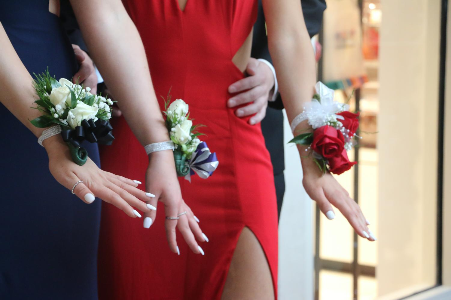 Senior girls showing their corsages at prom 2018