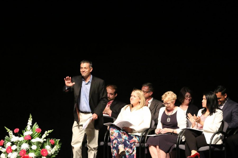Principal Dr. Jason Ness rises when announced to the audience.