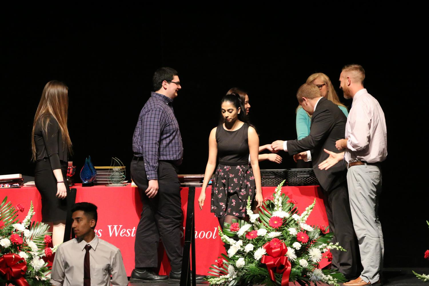 Students from 2018 lined up on stage waiting to receive their awards.