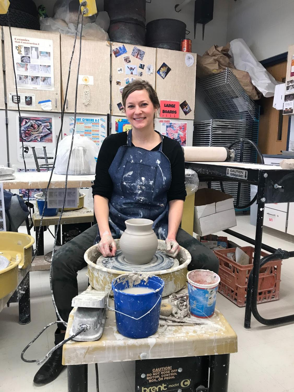 Art teacher Barbara Wismer showing off her pottery work.