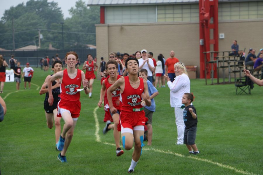 Pack of sophomores sprinting into the last 10 yards of their 3 mile.