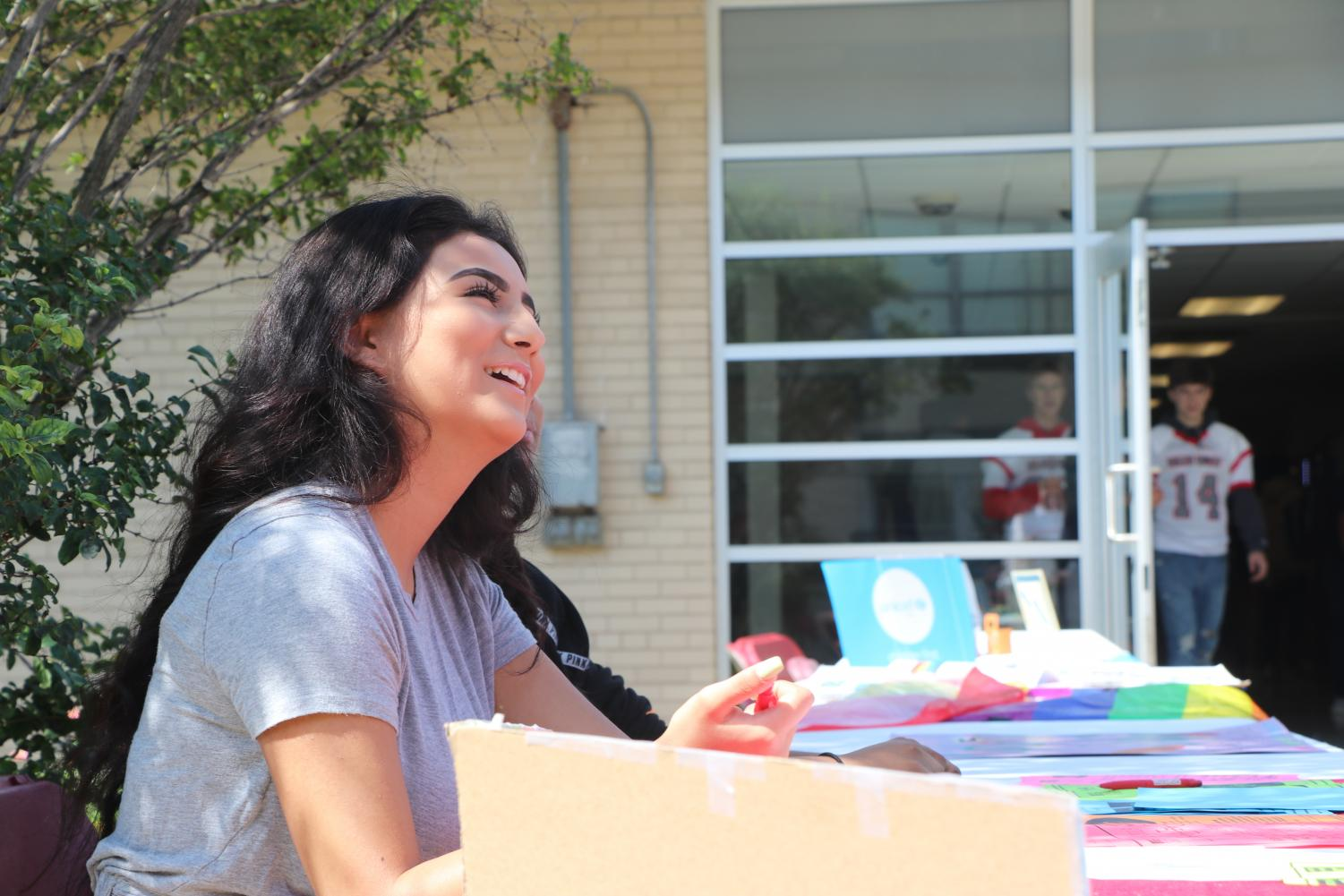 Student expresses their passion for Future Latino Club at Activities Fair.