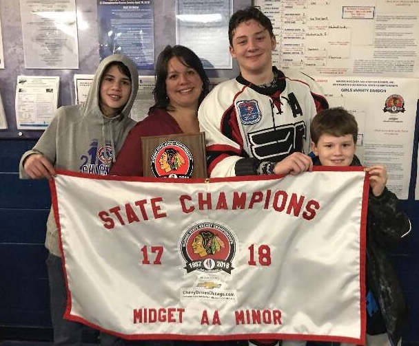 Senior+Austin+Kessem+with+his+mother+and+brothers%2C+after+winning+the+State+Championship.
