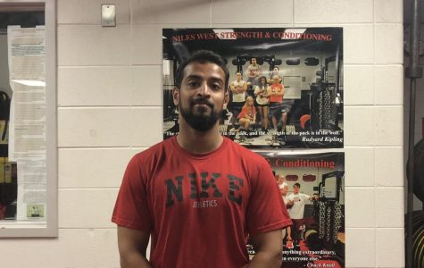Paraprofessional Maaz Ahmed is all smiles in the weight room.