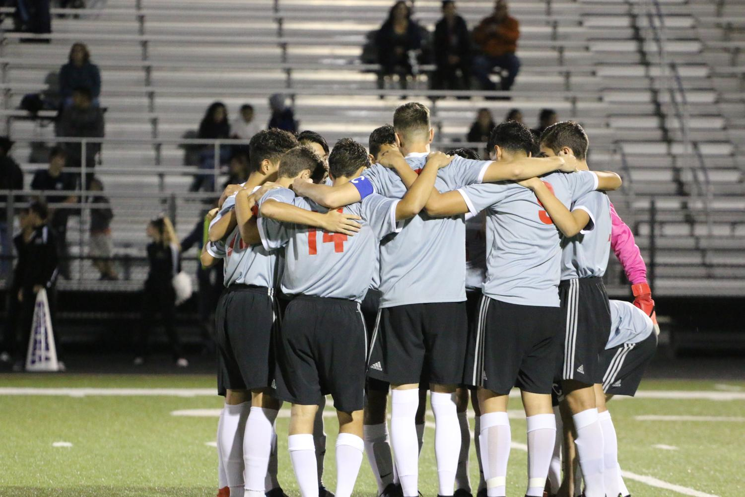 Players huddling before the game starts to have a great game