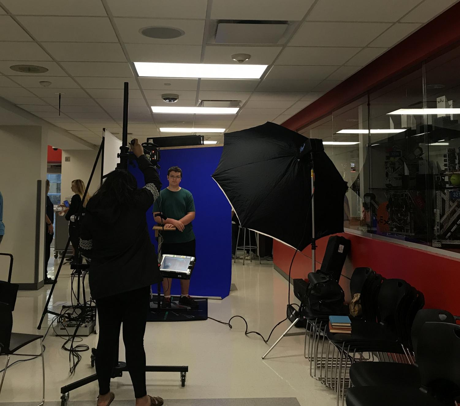 Students getting yearbook pictures taken during school.