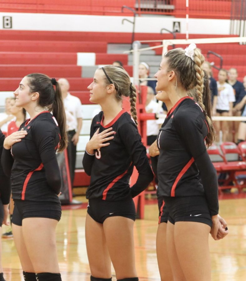 Freshman Gianna Pehar stands between her teammates during the national anthem.