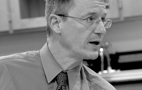 Science teacher Neil Koreman posing mid-class.