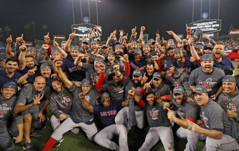 The World Series champion Boston Red Sox pose for a team photo on the field after defeating the Los Angeles Dodgers in Game 5 of the 2018 World Series at Dodger Stadium.
