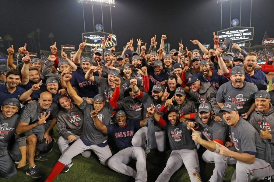The+World+Series+champion+Boston+Red+Sox+pose+for+a+team+photo+on+the+field+after+defeating+the+Los+Angeles+Dodgers+in+Game+5+of+the+2018+World+Series+at+Dodger+Stadium.