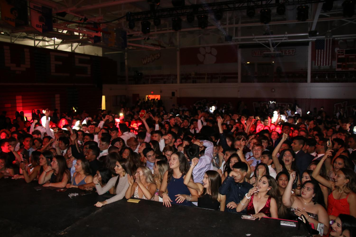 Students crowd the stage to watch the DJ and be closer to the music