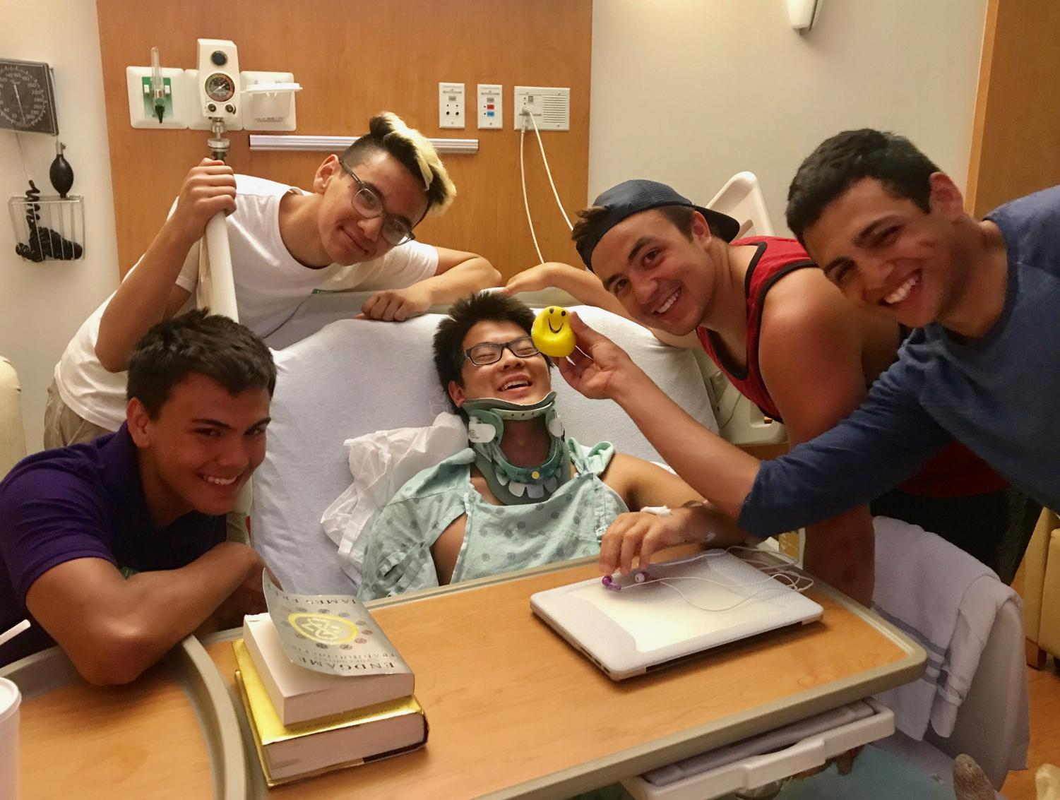 Shimabukuro being visited by his swim teammates in the hospital.