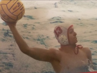Junior Brian Pryzby immerses himself in the water polo game.