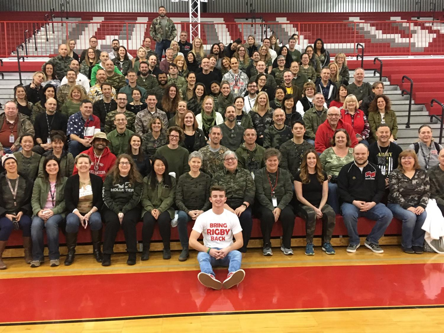 Staff members pose in the main gym sporting camo in support of Mark Rigby.