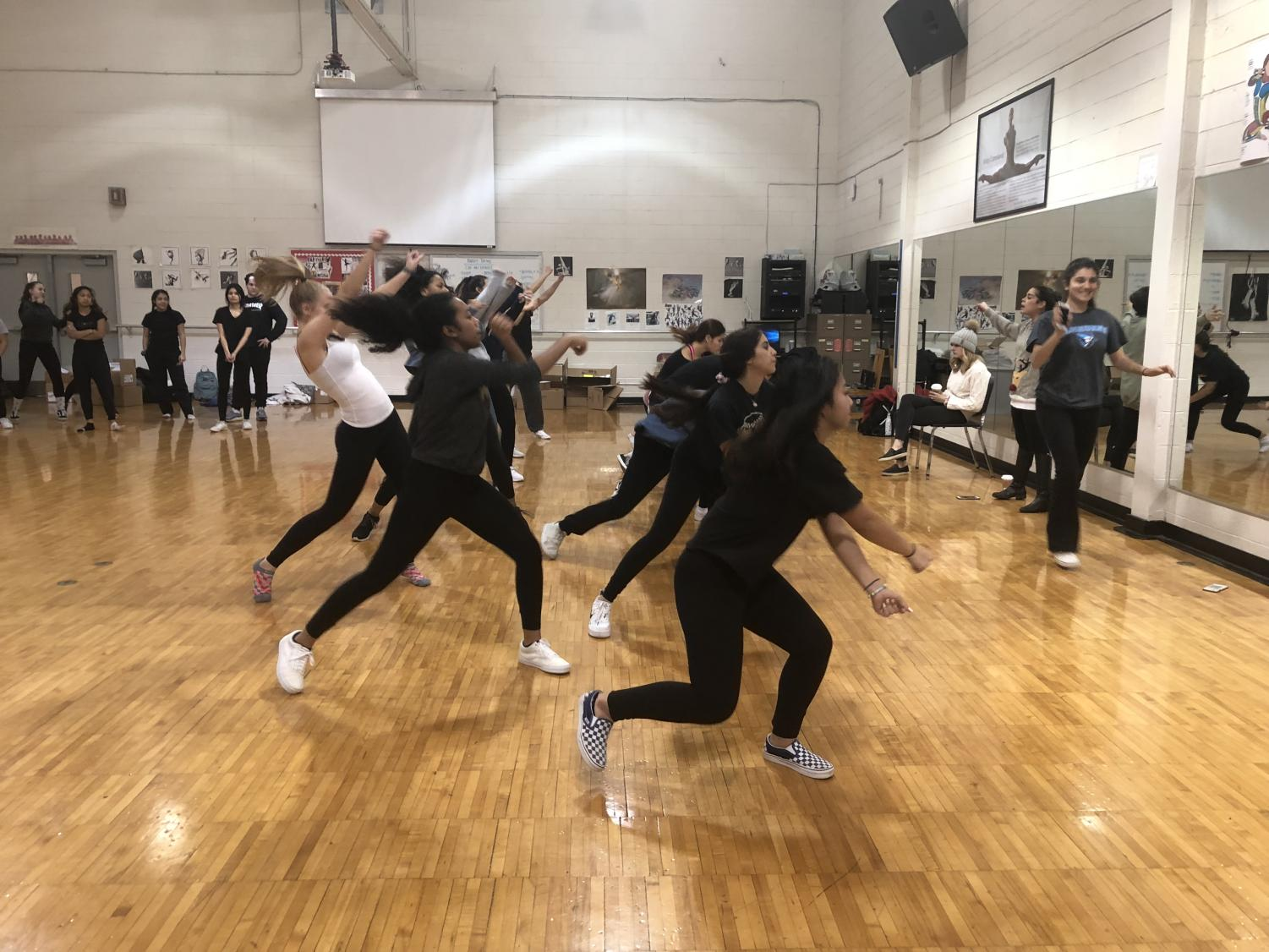 The poms team practicing their routine before the competition this past weekend.