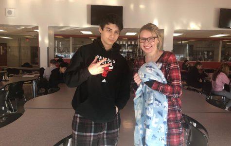 Seniors Richie Noparstak and Katrina Grunst posing in their pajamas.