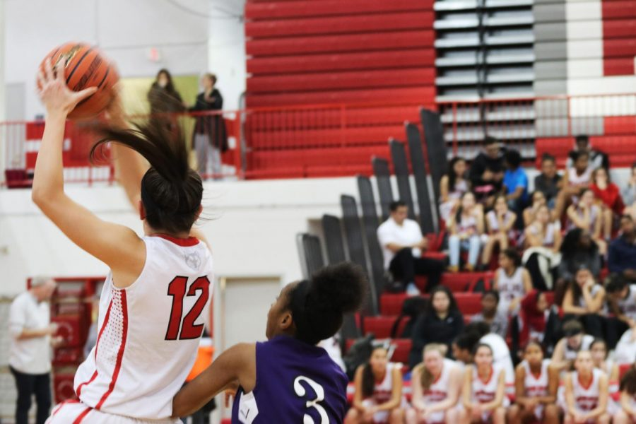 Sam Galanopaulos rebounding the ball from a shot that North missed.