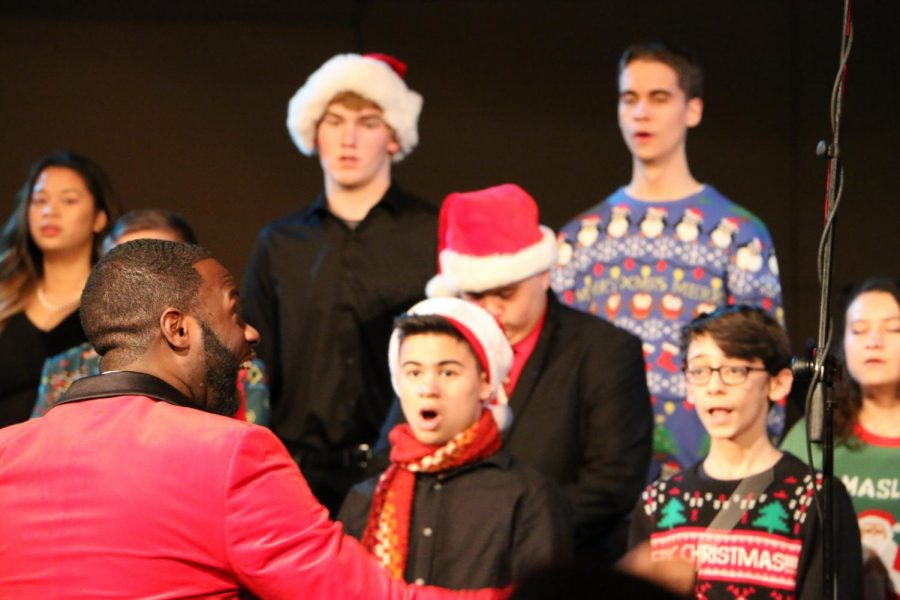 Hunter conducts the choir to sing for the crowd.