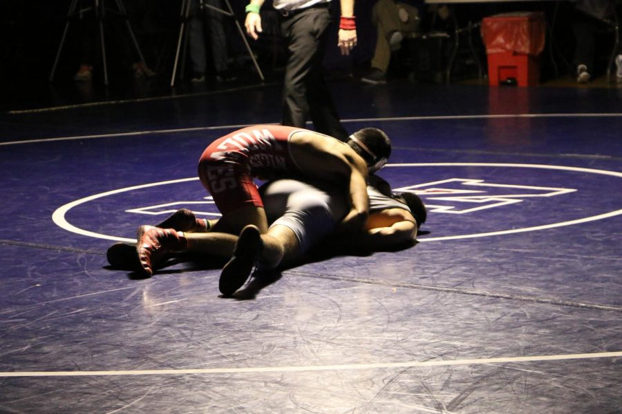 West student bests North by pinning his opponent for a short second.