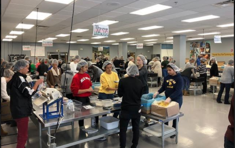 Civics students packing nutritional meals for malnourished children in various countries at the Feed My Starving Children Packing site in Libertyville, IL