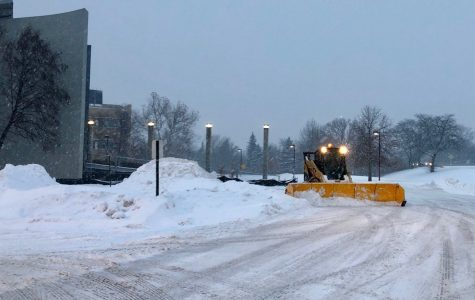 The Niles West faculty parking lot being plowed before school.