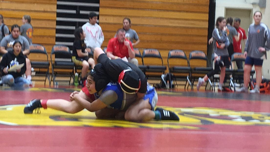 Junior Finn Holleran mid-match during a meet.
