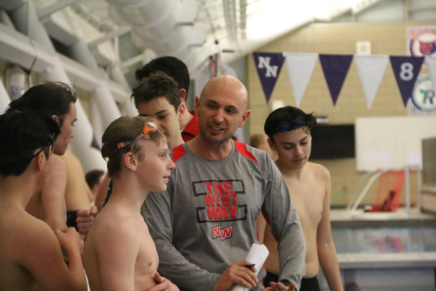 Coach+Macejak+talking+to+one+of+his+swimmers.