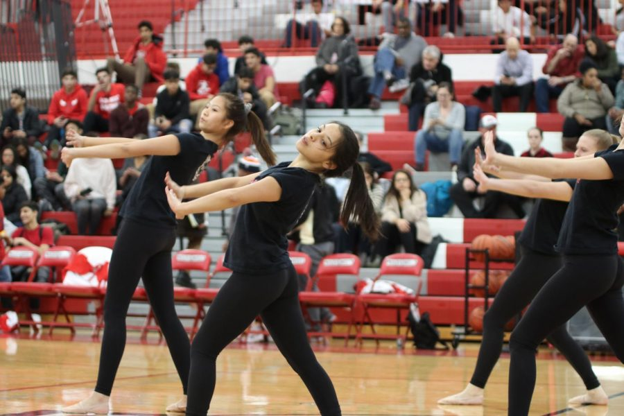 Niles West Poms team performs a lyrical piece at half time.