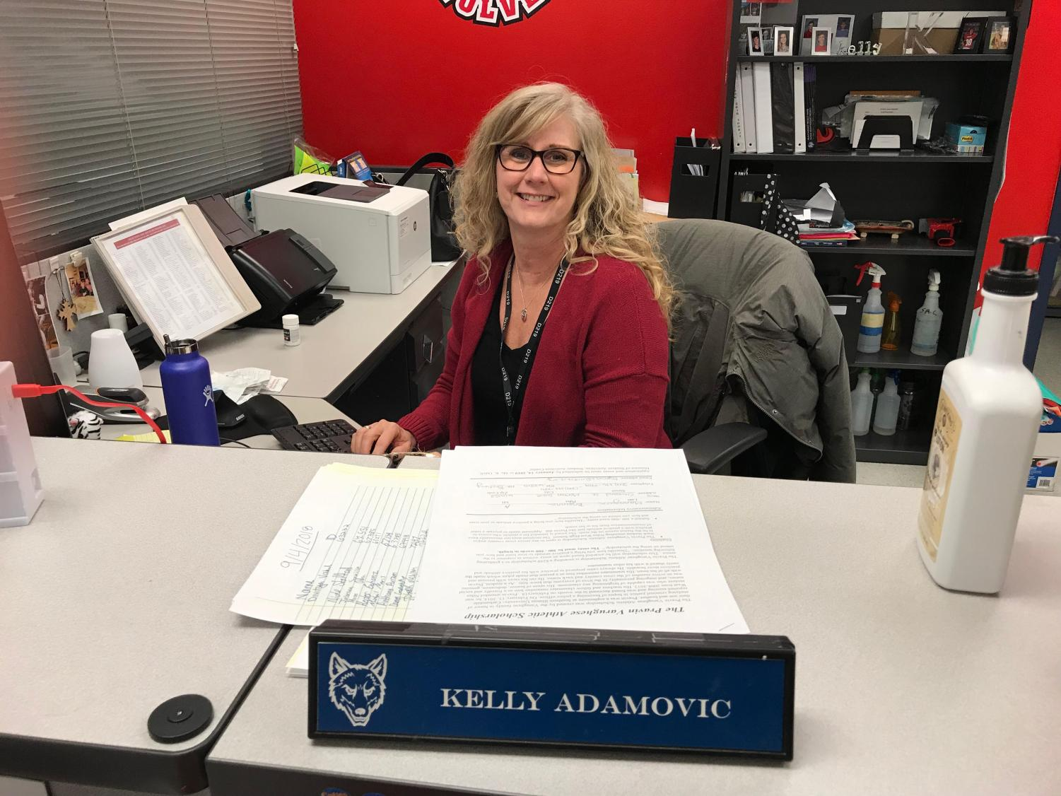Assistant Activities director, Kelly Adamovic, sits at her desk, ready to take on the day with a smile.