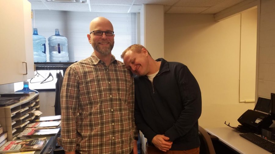 Social studies teachers Joseph Edwards and Matthew Wiemer pose for a picture in the social studies office.