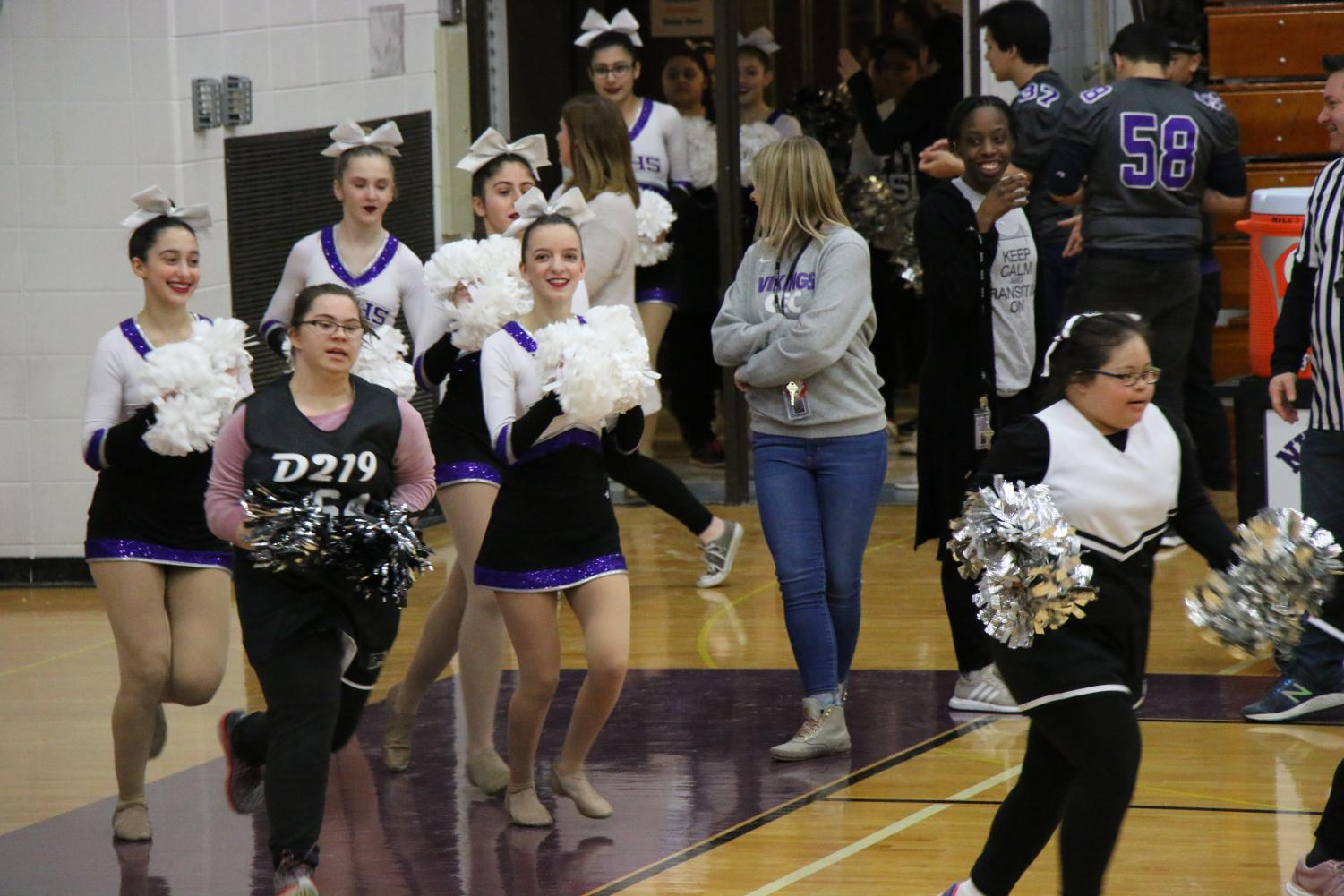 Niles+North+cheerleaders+leading+the+CEC+cheerleaders+to+their+spots+on+the+court+before+their+halftime+dance.