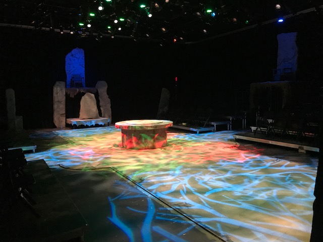 Lights shining on the set of the play Macbeth.