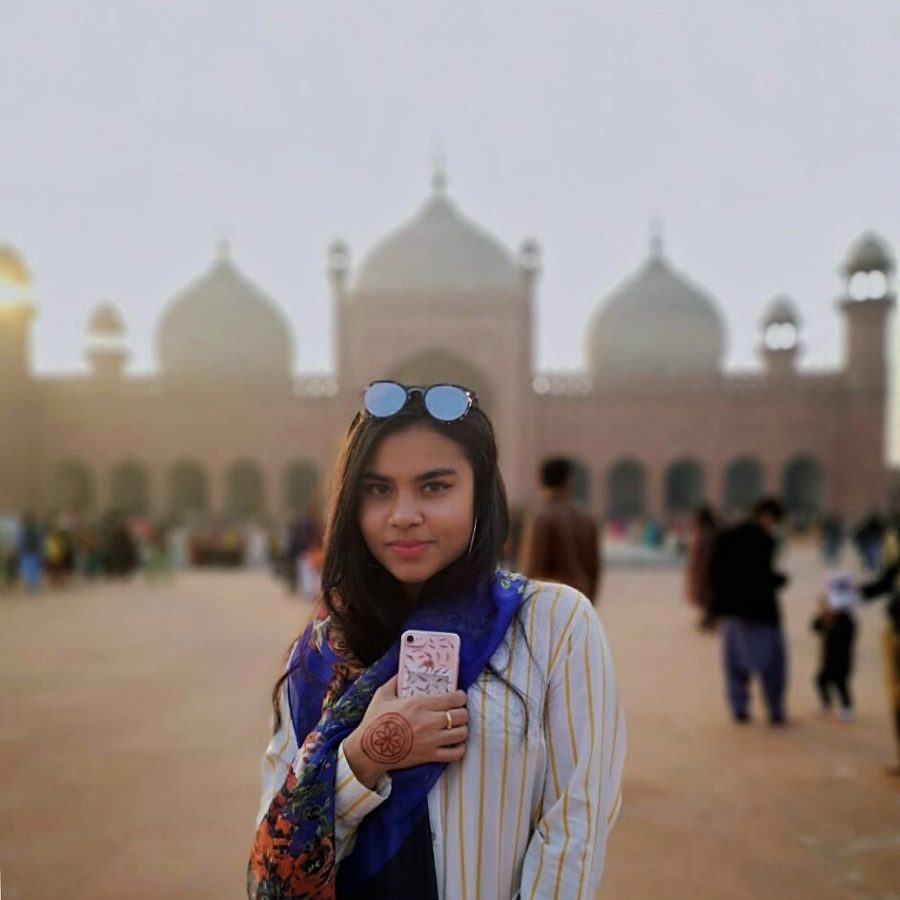 Senior Noormah Ayub in front of the Badshahi Mosque during her trip back home to Pakistan last December.