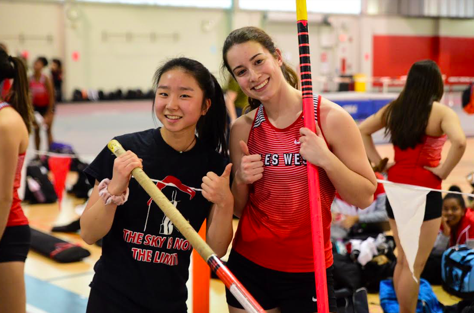 Junior Hana Choi (left) posing alongside a teammate before a meet.