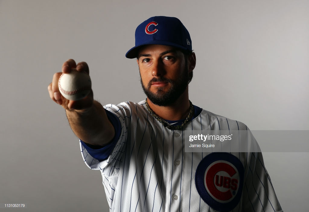 MESA, ARIZONA - FEBRUARY 20:   George Kontos #30 poses for a portrait during Chicago Cubs photo day on February 20, 2019 in Mesa, Arizona. (Photo by Jamie Squire/Getty Images)