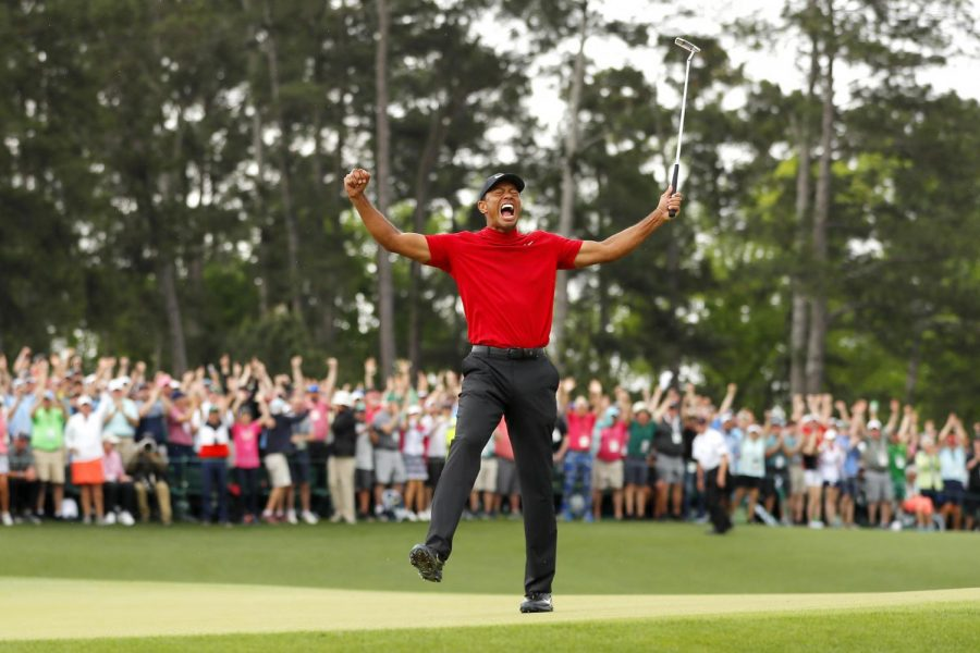 Tiger+Woods+won+his+fifth+Masters+title+at+Augusta+National+Golf+Club+on+Sunday%2C+nearly+11+years+after+his+last+major+win.