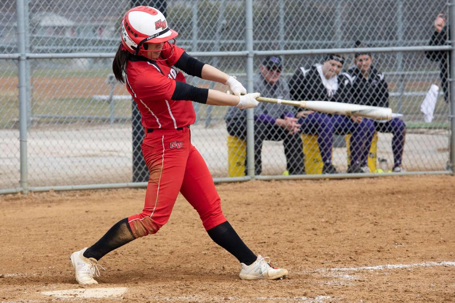 Junior Julia Ruth mid-swing during one of the softball games.