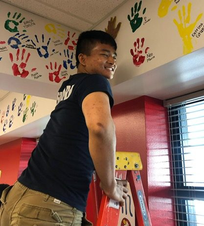 Senior Alan Duong leaving his print on Niles West walls.