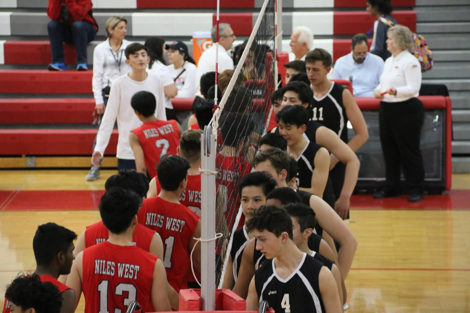 Niles West and Niles North teams shake hands to commence the match.