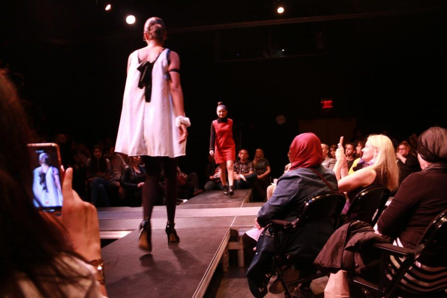 Students displaying their pieces during the fashion show.
