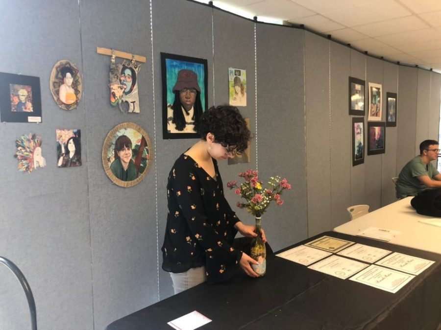 AP art student setting up her display to show others around West.
