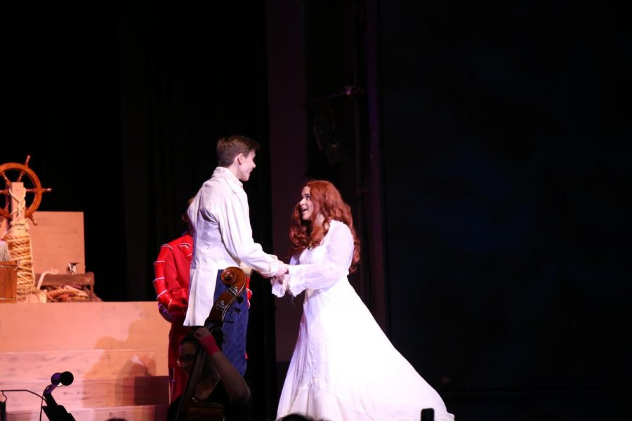 Ariel and Prince Eric get married and live Happily Ever After.