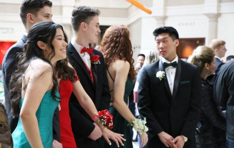 Seniors having a laugh as they attempt to take pictures for prom.